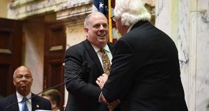 Gov. Larry Hogan shakes hands with Sen. Mike Miller in the Senate Chamber. (The Daily Record / Maximilian Franz)
