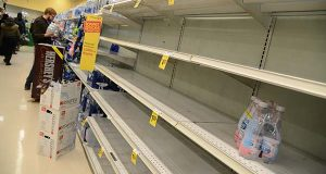 Shelves depleted of bottled water line an isle at the Safeway store in Charles Village the day before winter storm Jonas is forecasted to hit the Baltimore area with stong winds and from 12-24 inches of snow from Friday night through Saturday afternoon. (The Daily Record/Maximilian Franz).