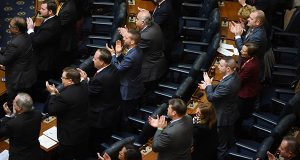 Delegates in the House chamber applaud during the first-day proceedings Wednesday. (Maximilian Franz / The Daily Record)