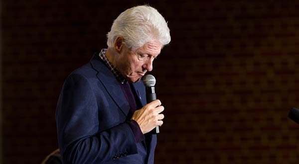 Former President Bill Clinton pauses as he speaks at a campaign stop for his wife Democratic presidential candidate Hillary Clinton at Lincoln High School in Des Moines, Iowa, Saturday, Jan. 16, 2016. (AP Photo/Andrew Harnik)