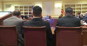 Three military veterans wait to testify in support of the Stolen Valor Act of 2016 at the Senate Judicial Proceedings Committee meeting in Annapolis on Tuesday. (Leo Traub / Capital News Service)