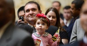 Delegate Kirill Reznik, Democrat from Montgomery County, holds his then-2 year old daughter, Caitlin, on the opening day of the General Assembly in 2015. (The Daily Record/Maximilian Franz)
