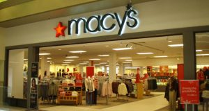 Macy's officials said sales fell 5.2 percent in November and December at existing stores. Warm weather and lower spending by international tourists hurt sales. Macy's said Wednesday that it now expects its profit for its fiscal fourth quarter and full year, which run through January, to fall short of its previous estimate. (File photo)