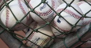 Major League Baseball settles with fans over game telecasts
