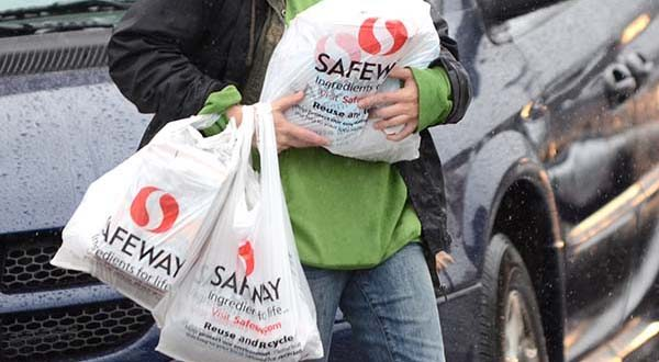 Supporters of an effort to reduce the use of plastic and paper bags say a proposed new fee would help encourage shoppers to consider the environment at the same time they are looking for the best deals. (File)