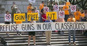 FILE - In this Oct. 1, 2015, file photo, protesters gather on the West Mall of the University of Texas campus to oppose a new state law that expands the rights of concealed handgun license holders to carry their weapons on public college campuses. The University System of Maryland is lending its support to a plan to ban guns and other deadly weapons on the state's public higher education campuses – so long as some exceptions are protected. (Ralph Barrera/Statesman.com via AP, File)