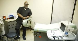 In this photo taken Feb. 22, 2016, Dr. Willie Parker stands in a procedure room for a portrait at the West Alabama Women's Center in Tuscaloosa, Ala. (AP Photo/Brynn Anderson)