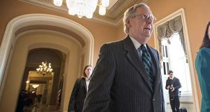 Senate Majority Leader Mitch McConnell walks to the chamber where he offered a tribute to the late Supreme Court Justice Antonin Scalia whose death has triggered an election-year political standoff, on Capitol Hill in Washington on Monday. (AP Photo/J. Scott Applewhite)