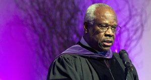In this Jan. 26, 2012 file photo, Supreme Court Justice Clarence Thomas speaks at College of the Holy Cross in Worcester, Mass. Thomas has asked questions during Supreme Court arguments for the first time in 10 years. Thomas' question came Monday, Feb. 29, 2016, in a case in which the court is considering placing new limits on the reach of a federal law that bans people convicted of domestic violence from owning guns. (AP Photo/Michael Dwyer, File)