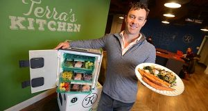 Mike McDevitt, CEO of Terra's Kitchen, seen here holding a cooked plate of food with eco-friendly delivery vessel that the business uses to deliver its pre prepped ingredients to its customers. (The Daily Record/Maximilian Franz)