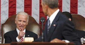 n this Jan. 12, 2016 file-pool photo, Vice President Joe Biden points at President Barack Obama during the president's State of the Union address to a joint session of Congress on Capitol Hill in Washington. President Barack Obama is creating a new federal task force to accelerate cancer research. He's tapping Biden to chair the effort.  (AP Photo/Evan Vucci, Pool, File)