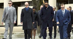 Officer Edward Nero, left, Lt. Brian Rice, attorney Ivan Bates and Officer Garrett Miller leave the Maryland Courts of Appeal building in Annapolis on Thursday afternoon. The Court of Appeals heard oral arguments in five cases related to the arrest and death of Freddie Gray last year. (AP Photo/Jose Luis Magana)