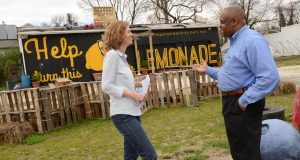 Regina Lansinger, director of Hamilton-Lauraville Main Street, chats with Marvin Perry, research development associate with Morgan Community Mile, at the proposed site of a community kitchen at 4500 Harford Road. (Maximilian Franz/The Daily Record)