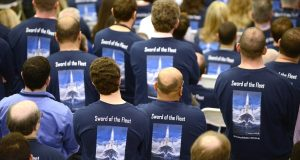 Lockheed Martin workers, wearing shirts that read 'Sword of the Fleet' and depict the Navy's MK 41 Vertical Launching System, gather for an event Thursday to commemorate the return of production to the Middle River plant. (Maximilian Franz / The Daily Record)