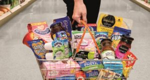 A shopper holds a basket of Premier Foods products in the aisle of a supermarket. McCormick & Co. said it will not make an offer on Premier Foods, after the British food maker agreed to come to meet with the Sparks spicemaker on March 30. (Courtesy of Premier Foods)