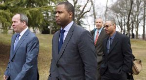 Officer William Porter, center, one of six Baltimore city police officers charged in connection to the death of Freddie Gray, leaves the Maryland Court of Appeals on Thursday, March 3, 2016, in Annapolis, Md. Maryland Court of Appeals heard the oral arguments in five cases related to the arrest and death of Freddie Gray. (AP Photo/Jose Luis Magana)