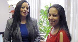 Adelaida Torres, right, poses with her legal aid lawyer, Linda Allard, in Hartford, Conn., Torres believes she never would have won custody of her two daughters in 2013 during a bitter court fight with her now-ex-husband if not for the free legal help from Allard and Greater Hartford Legal Aid. Connecticut lawmakers are considering a bill that would create a task force to look into expanding the right to free lawyers for the poor in civil cases. (AP Photo/Dave Collins)