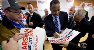 "In this Feb. 6, 2016, file photo, Republican presidential candidate, Dr. Ben Carson meets with attendees during a visit to a campaign office in Manchester, N.H. Carson ran for president, and his consultants won. The political newcomer who said March 2, he sees ""no path"" to the Republican nomination raised more money than any other GOP contender, $58 million since he began his bid last May. But Carson's campaign burned through much more of that money on fundraising and consultants than on mass media advertising, on-the-ground employees and other things that could have swayed voters, an Associated Press review of his campaign finance reports found. (AP Photo/Matt Rourke, File)"