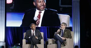 Republican presidential candidate retired neurosurgeon Ben Carson, left, is interviewed by author and radio host Eric Metaxas, right, at the National Religious Broadcasters convention Friday, Feb. 26, 2016, in Nashville, Tenn. (AP Photo/Mark Humphrey)