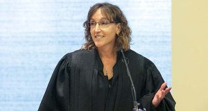 In this photo taken Aug. 2, 2014, photo provided by The Gazette, Jane Kelly speaks during her investiture ceremony as an 8th U.S. Circuit Court of Appeals judge at the United States Courthouse for the Northern District of Iowa, in Cedar Rapids, Iowa. As a federal appeals court judge, Kelly has an unusual background: she's a criminal defense lawyer and a Harvard Law School classmate of President Barack Obama. A Fulbright scholar, Kelly became only the second woman named to the St. Louis-based 8th U.S. Circuit Court of Appeals in 2013 after nearly two decades as a federal public defender in Iowa. (Liz Martin/The Gazette via The AP)