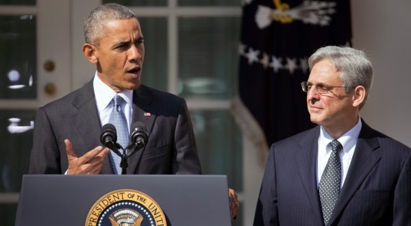 Federal appeals court judge Merrick Garland, right, stands with President Barack Obama as he is introduced as Obama's nominee for the Supreme Court during an announcement in the Rose Garden of the White House, in Washington, Wednesday, March 16, 2016. (AP Photo/Pablo Martinez Monsivais)