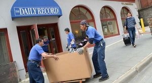 Movers help relocate The Daily Record's offices to St. Paul Plaza. Pictured here is the former Daily Record office. (The Daily Record / Maximilian Franz)