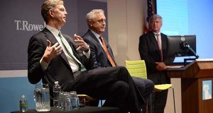 From left, Edward Bernard, vice chairman,  Bill Stromberg- CEO and Brian Rogers, chairman of the board, speaking at the T. Rowe Price annual shareholders meeting.