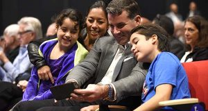 During the 2016 Under Armour Stockholders Meeting in Port Covington, Kevin Plank takes a selfie with his wife Desiree Jacqueline Guerzon, daughter Katherine Plank and son Kevin James Plank. (The Daily Record/Maximilian Franz)
