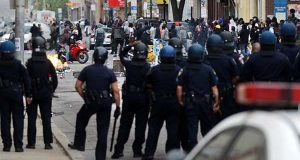 Police watch rioters on April 27, 2015 at an intersection in the Penn-North neighborhood. (File)