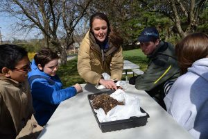 Carrie Buppert Frasure shows students from The Harbor School what mulch looks like. (The Daily / Maxmilian Franz)