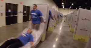 "(YouTube / Guinness World Records / ""Largest human mattress dominoes"")"