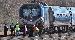 Backhoe in Amtrak wreck had periodic right to be on tracks