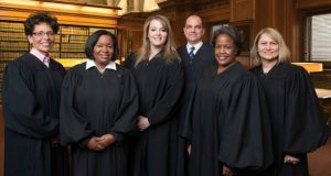 The sitting judges on the Baltimore City Circuit Court on this year's primary ballot. From left: Judge Audrey J.S. Carrion, Judge Wanda Keyes Heard, Judge Karen Chaya Friedman, Judge Michael A. DiPietro, Judge Cynthia H. Jones and Judge Shannon E. Avery. 'We've been really trying to educate people on basic stuff that we need them to know about us and the campaign and the vetting process to other things that are going on in the system,' Friedman says of campaigning. (Photo courtesy of Baltimore City Sitting Judges Committee)
