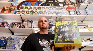 Jason Barnes, owner of All Time Toys in historic Ellicott City, seen here holding a Dragonzord toy in box from 1993 in his shop that they are selling for $150. (The Daily Record/Maximilian Franz)