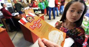 Isabella Yip looks at an Ice Cream Trail brochure at the Woodbourne Creamery at Rock Hill Orchard on May 22, 2016 in Mount Airy, Md.   (Kenneth K. Lam/The Baltimore Sun via AP)
