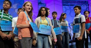 The final ten spellers who made it into the evening televised final round gather around each other on stage  after the completion of the morning of competition of the 2016 National Spelling Bee, in National Harbor, Md., on Thursday, May 26, 2016. From left are Sreeniketh Vogoti, 13, of Saint Johns, Fla., Sylvie Lamontagne, 13, of Lakewood, Colo., and Snehaa Kumar, 13, of Folsom, California. (AP Photo/Jacquelyn Martin)
