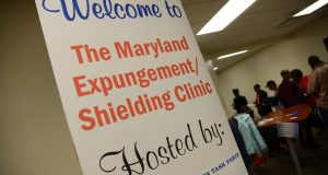 A sign outside a legal assistance program in Baltimore in October. Changes in Maryland's expungement law have led to a flood of requests in state court system. (File photo)