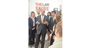 Missouri lawyer Ed Hershewe, center, speaks at the grand opening of The Law Store inside the Wal-Mart in Neosho, Missouri, earlier this month. Hershewe created the unusual law practice, which is separate from his personal injury firm, to serve walk-in clients who've come to Wal-Mart to shop. (Submitted photo)