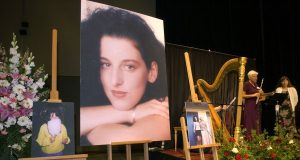 Photos of Chandra Levy are on display as musicians, right, stand by at the memorial service for Levy in May 2002 at the Modesto Centre Plaza in Modesto, Calif. Prosecutors said Thursday they will not retry a man convicted of killing Washington intern Chandra Levy. The U.S. Attorney's office said in a statement the office has moved to dismiss the case charging Ingmar Guandique with Levy's 2001 murder. Prosecutors concluded they could not convict Guandique 'based on recent unforeseen developments that were investigated over the past week.' AP File Photo