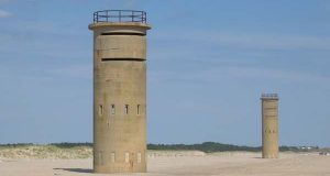 "World War II towers at Rehoboth Beach in 2006. (Flickr / Darren and Brad / ""IMG_6769.JPG"" / CC BY-SA 2.0 / cropped)"