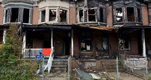 On Tuesday morning, a two-alarm fire destroyed six vacant homes on Fenwick Avenue in the Coldstream-Homestead-Montebello community in Baltimore. (The Daily Record / Maximilian Franz)