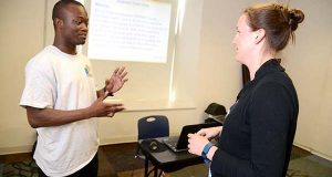 From Left, Mawuli Kponmassi, BCCC student going to Frostburg State for Pre-med in the fall, works  with Program coordinator Katie Graul during a public speaking workshop at the Urban Alliance. (The Daily Record/Maximilian Franz)