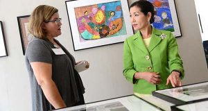 Cathy Goucher, Co-Founder of Make Studio, speaking with Yumi Hogan, the first lady of Maryland, during her visit to Make Studio at the Schwing Art Center in Hampden, which provides work space and other support for emerging artists with disabilities. (The Daily Record/Maximilian Franz)