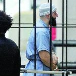 FILE - In a Wednesday, Feb. 3, 2016 file photo, Adnan Syed enters Courthouse East in Baltimore prior to a hearing.  (Barbara Haddock Taylor/The Baltimore Sun via AP, File)
