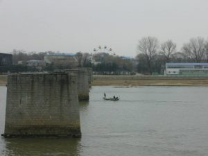 A view of North Korea from the Chinese city of Dandong in January 2014. When viewed with binoculars, the Ferris wheel appears two-dimensional, as if made of plywood. (Photo by the author).
