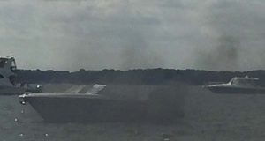 A boat smolders on the Magothy River after eight boaters were rescued. (Twitter / Maryland Natural Resources Police)