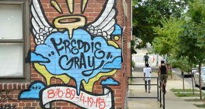 A tribute to Freddie Gray is seen painted on teh walls at Gilmor Homes, where he was arrested in May 2015. (The Daily Record / Maximilian Franz)