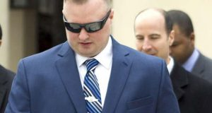 Officer Garrett Miller leaves the Court of Appeals in March. The top court ruled earlier this year that Miller and five other officers charged in connection with the death of Freddie Gray can be called to testify against co-defendants so long as they are granted use and derivative use immunity. (AP Photo/Jose Luis Magana)
