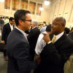 Tom Geddes, CEO of Plank Industries speaking with Councilman Carl Stokes before the Port Covington hearing on Tuesday, August 16th. (The Daily Record/Maximilian Franz)