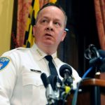 'The formula for a healthy crime fight is addressing all crimes, not just one, and for too long we've put all our eggs in the homicide basket at the expense of other crimes,' says Baltimore police Commissioner Kevin Davis, seen here addressing reporters Wednesday about the Justice Department's report on the department. (Kim Hairston/The Baltimore Sun via AP)